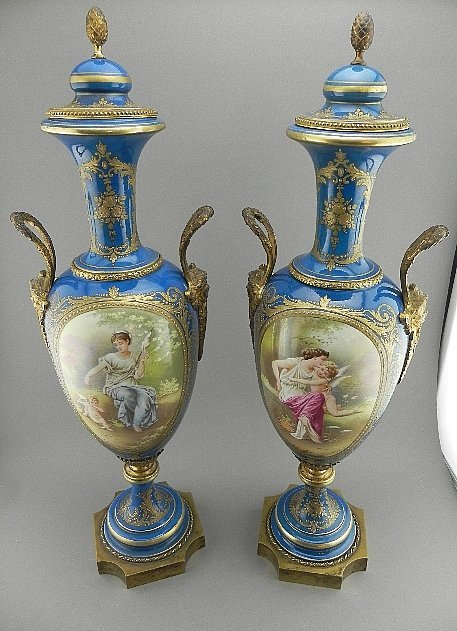 Pair of Sevres Style Urns. Signed E. Grisard