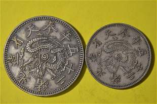 TWO CHINESE OLD SILVER COINS