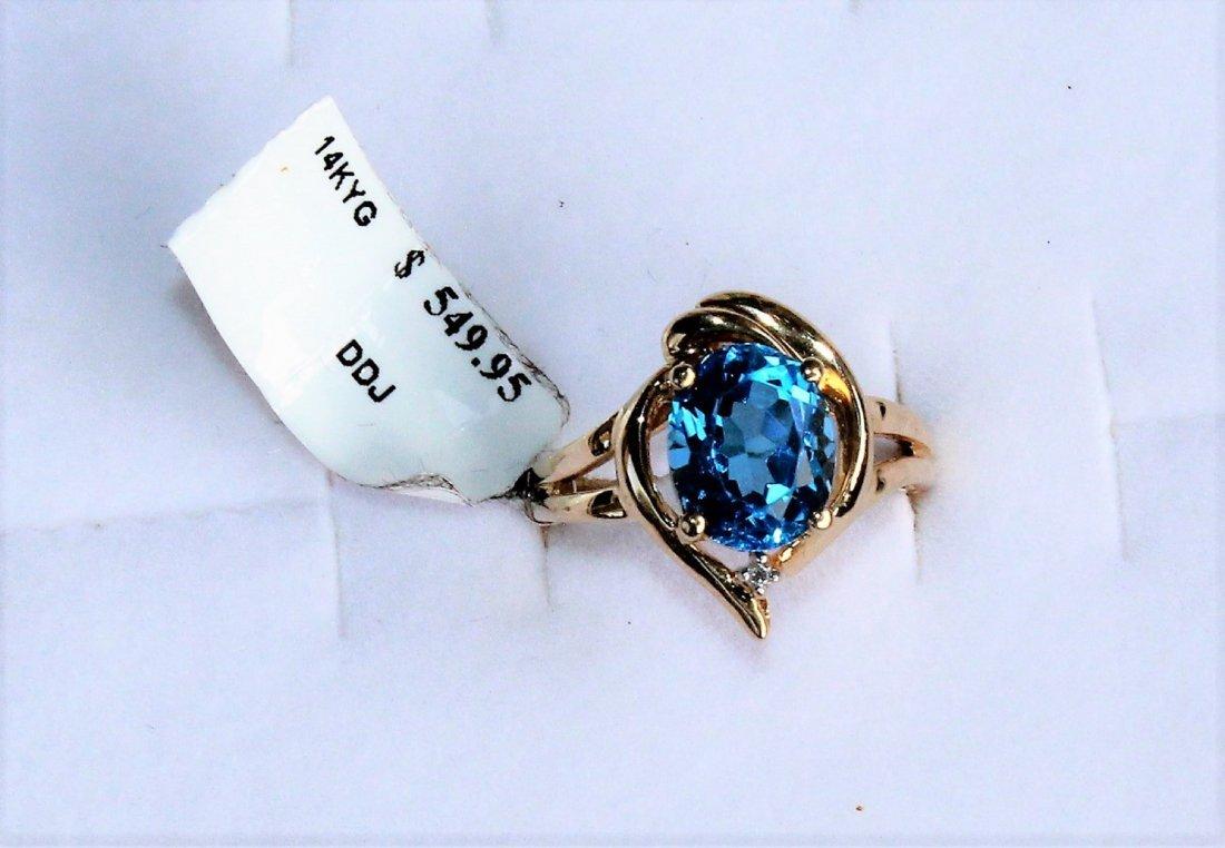 Columbia Emeralds 2.56 Carat Blue Topaz 14K Gold Ring