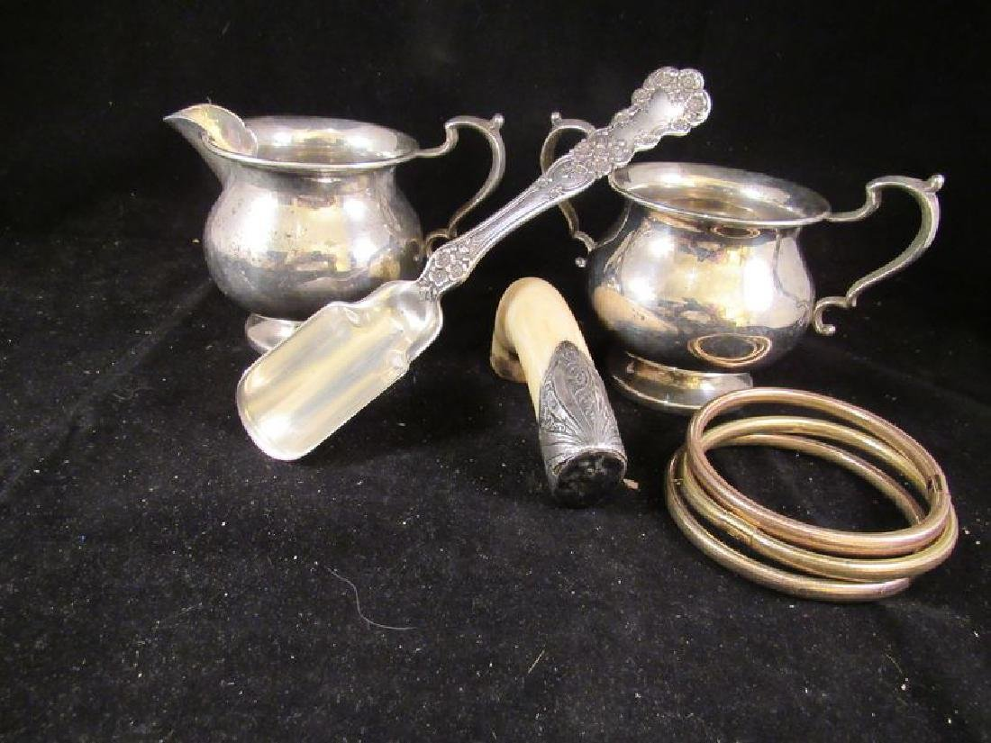 Sterling cheese scoop,plus .925 and 14k