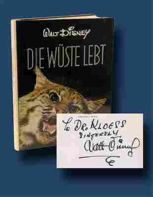 Walt Disney Boldly Signs a Copy of the Book Die Wuste
