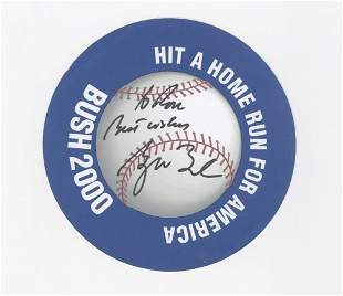 George Bush Signs a Decorative Campaign Disk in 2000