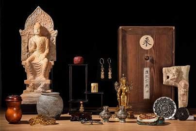 A pottery seated Buddha