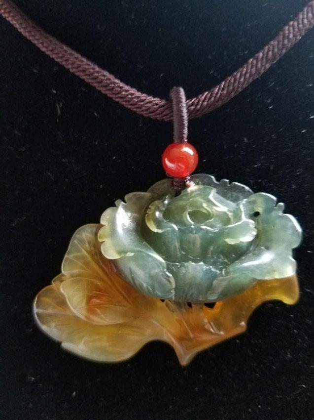 A Blue Jade Pendant