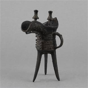 A BRONZE LIBATION CUP (JUE)