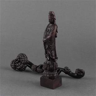 A GROUP OF CARVED WOOD GUANYIN AND RUYI