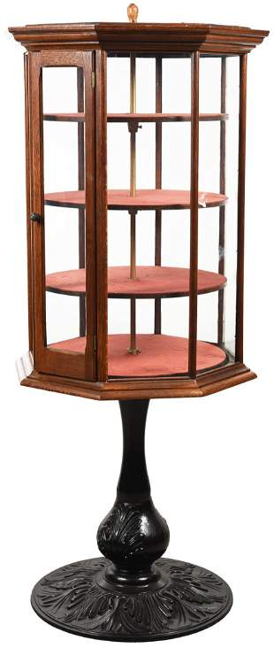 Oak Octagon Revolving Showcase on Ornate Cast Iron