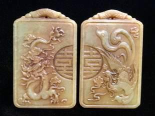 TWO CHINESE JADE PENDANTS