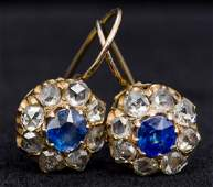 A pair of unmarked gold, diamond and sapphire earrings