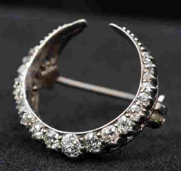 A Victorian unmarked diamond set brooch Of crescent