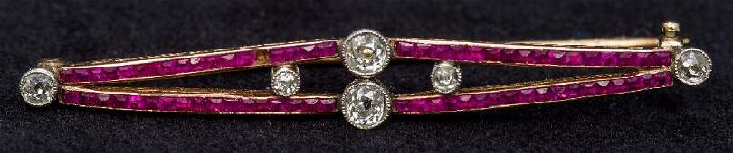 An Art Deco unmarked gold, diamond and ruby bar brooch