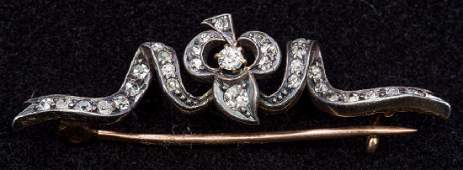 A Victorian unmarked gold and diamond bar brooch Of