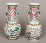 A pair of 19th century Chinese famille rose vases Each