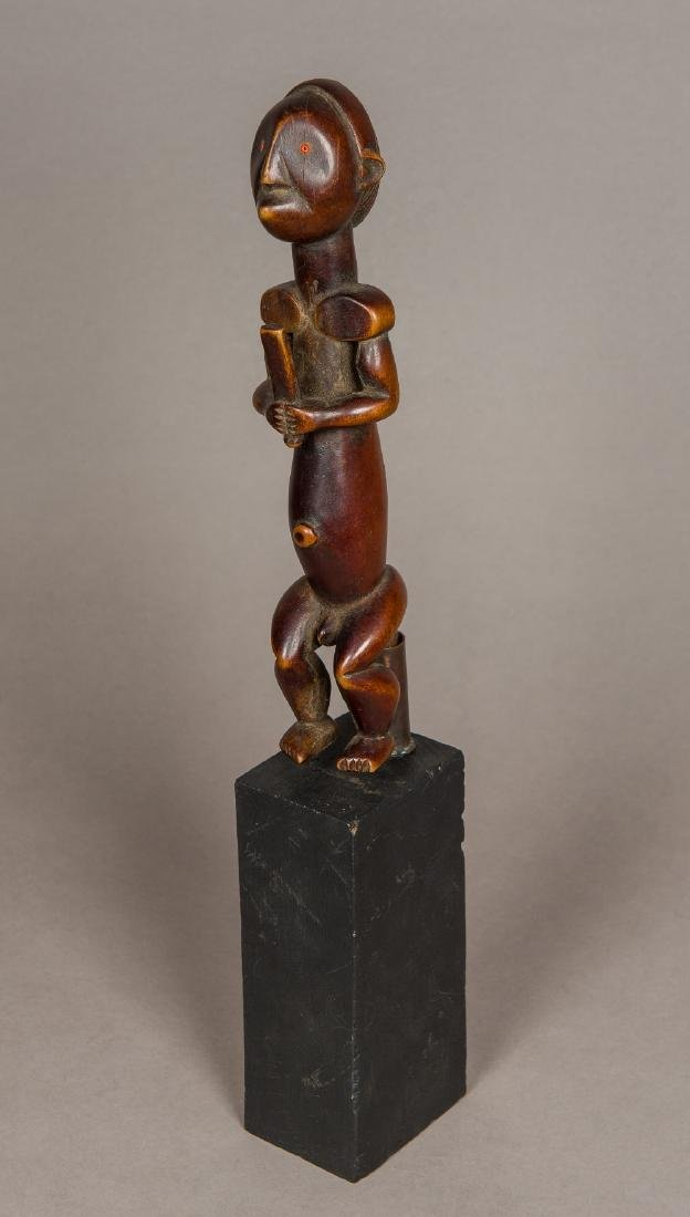 An African tribal carved wooden fertility figure Formed