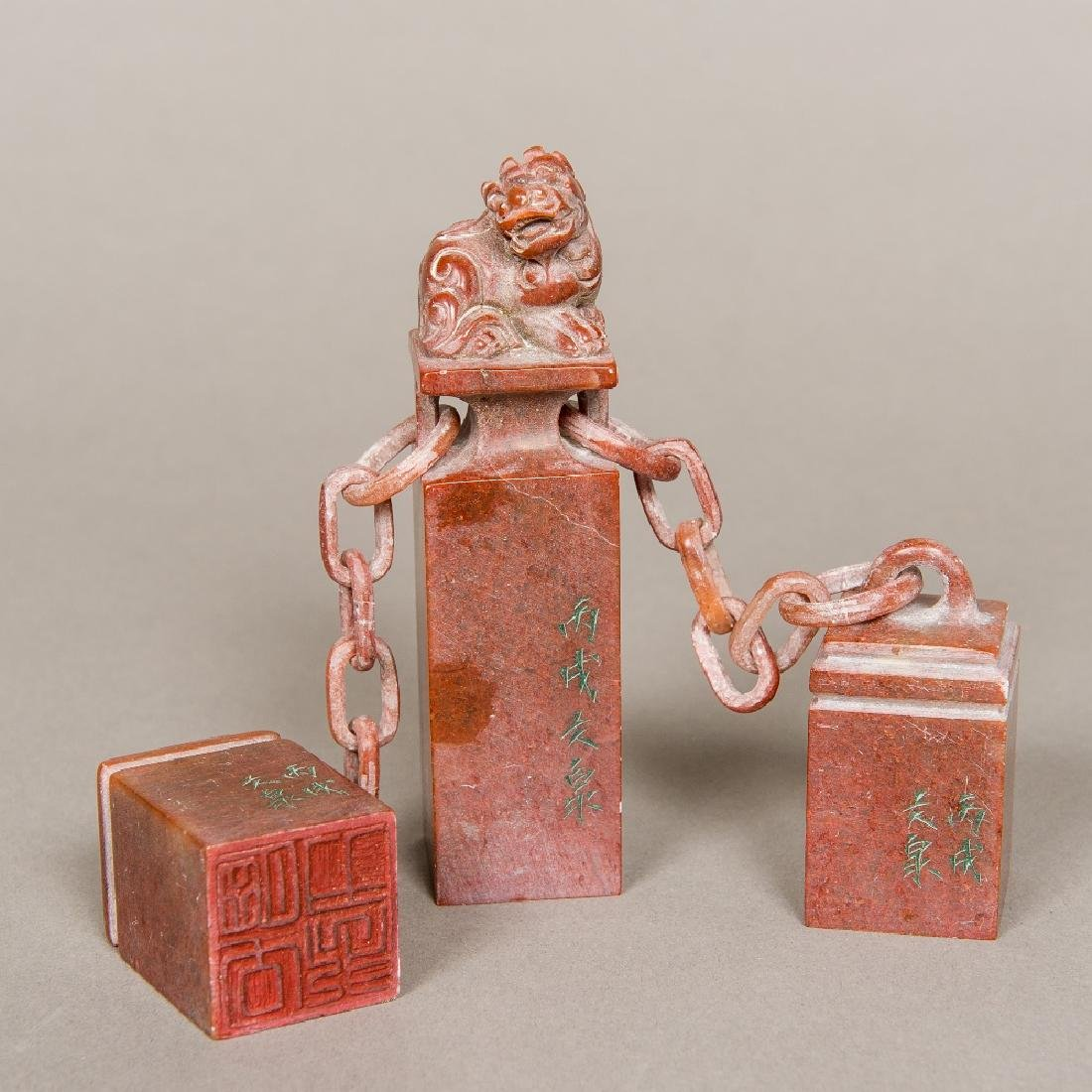 A set of three Chinese carved soapstone seals The