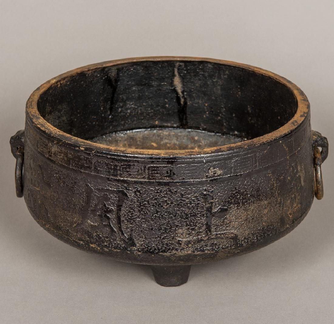 A large Chinese cast iron censer Of squat twin handled