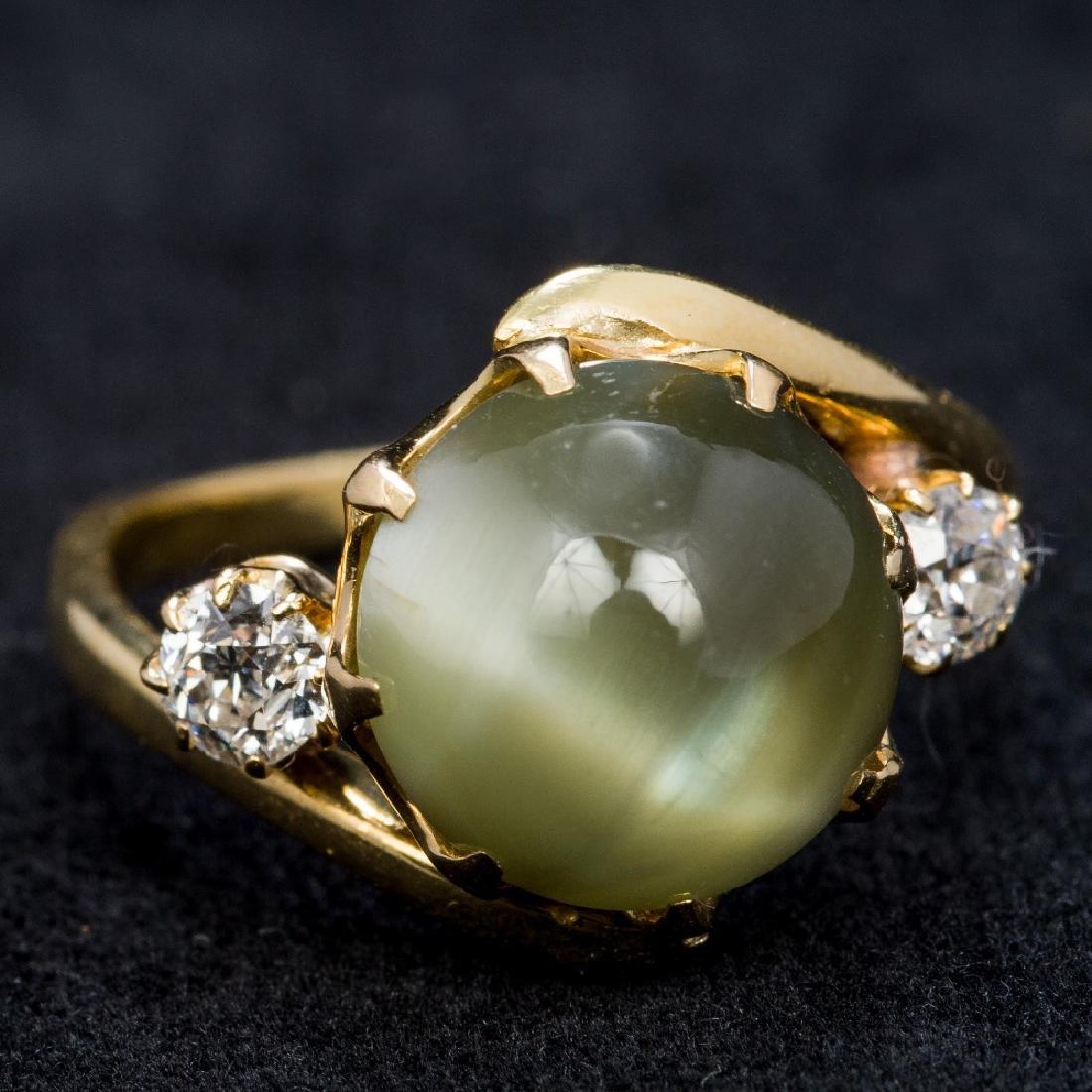 An 18 ct gold chrysoberyl cats eye and diamond cross