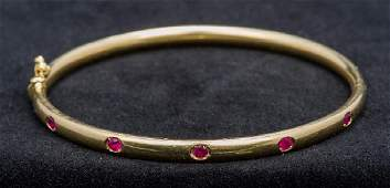 A Thurlow and Champness ruby set 18 ct gold bracelet Of