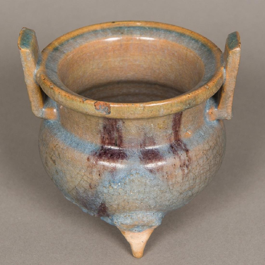 A Chinese pottery censer Of squat twin handled form,