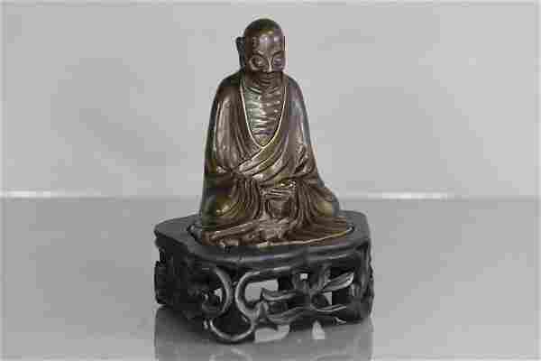 Bronze buddha statue with stand