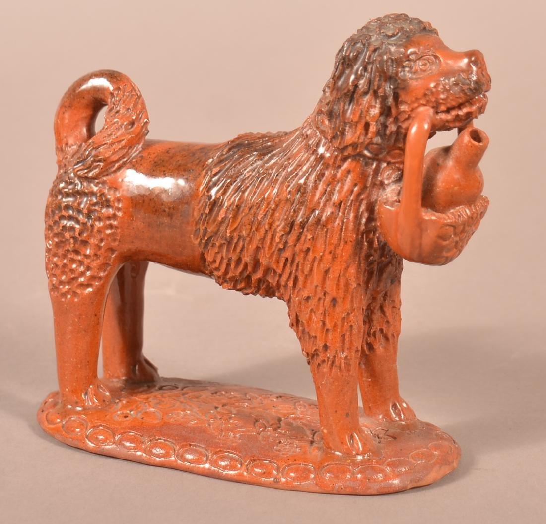 Pennsylvania 19th Century Redware Dog Figure.