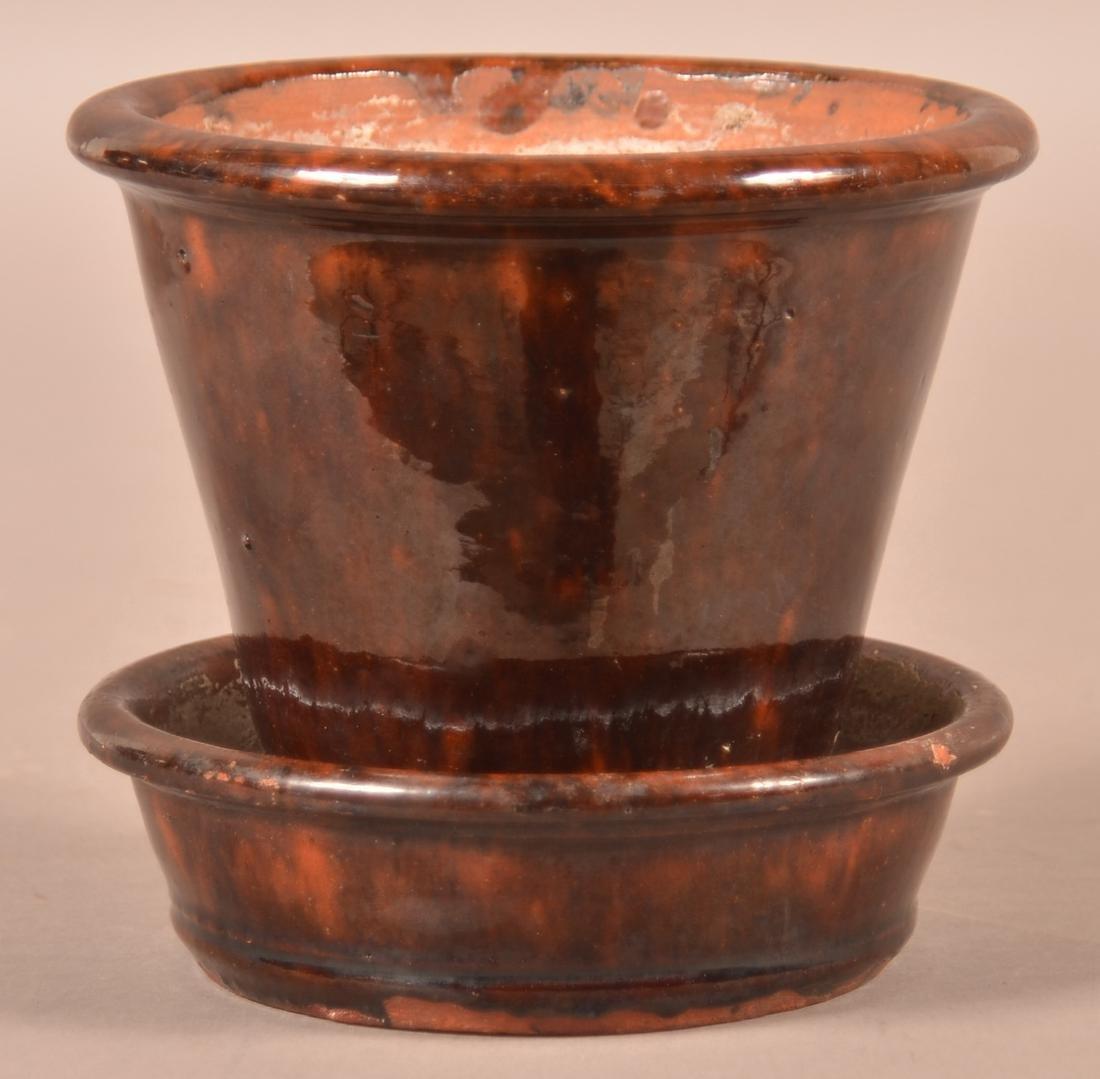 Mottle Glazed Redware Flower Pot.