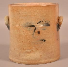 American Stoneware Crock with Face Decoration.