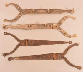 Two Pair of Wrought Iron Rams Horn Hinges.