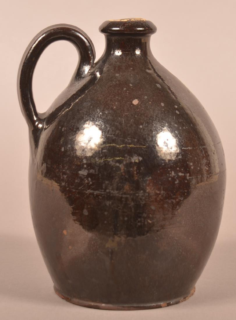 19th Century Manganese Glazed Redware Jug.