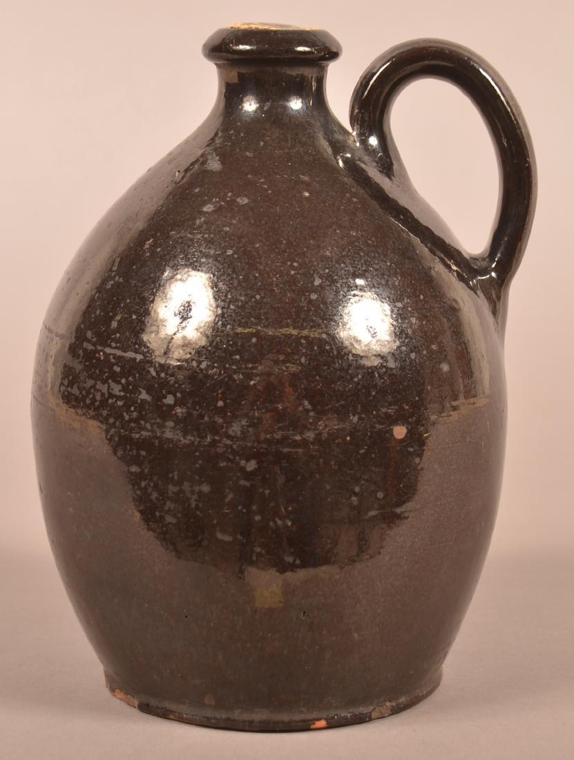 19th Century Manganese Glazed Redware Jug. - 2