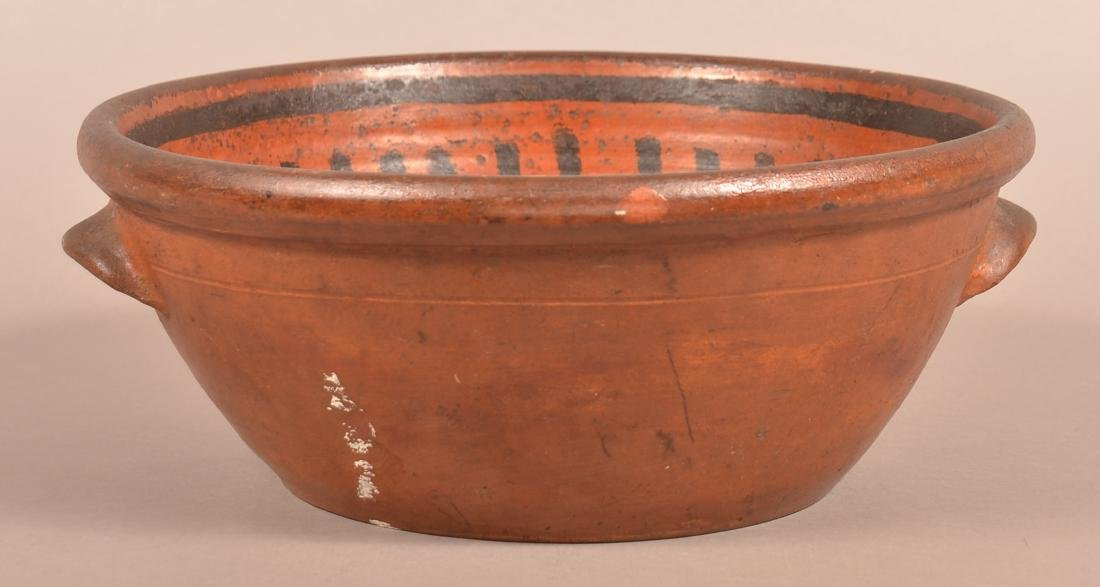 Glazed Redware Bowl with Applied Ear Handles.