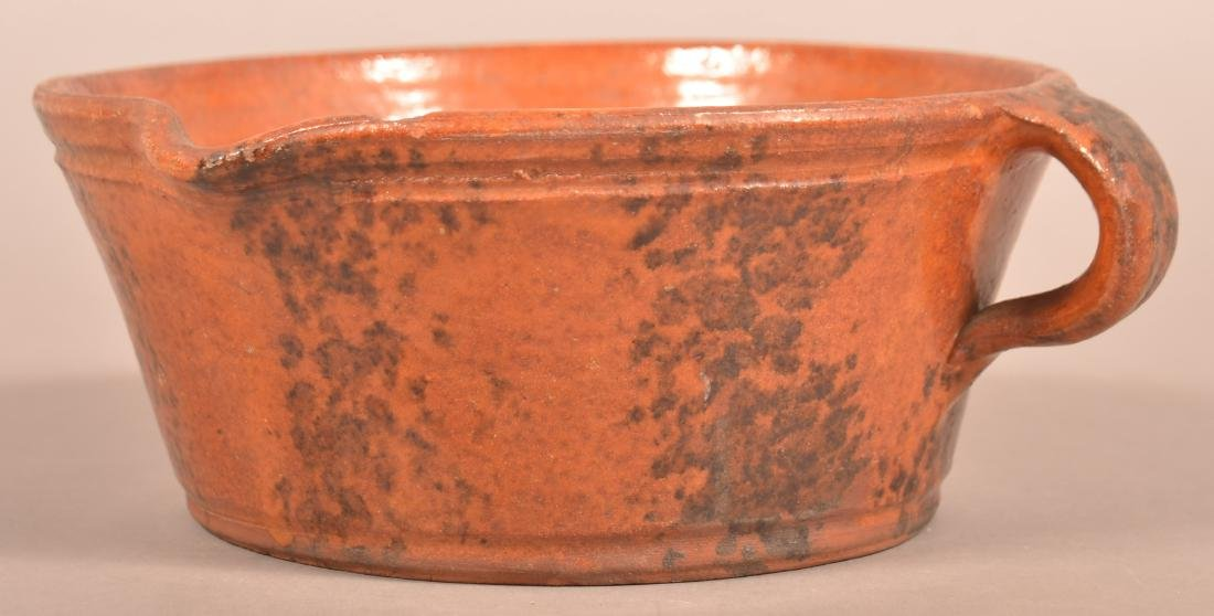 19th Century Sponge Glazed Redware Milk Bowl.
