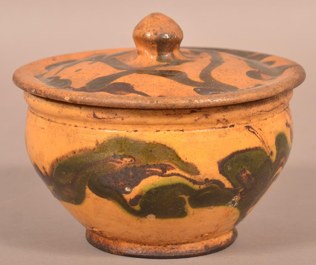 19th Century Drip Glazed Redware Covered Sugar Bowl.