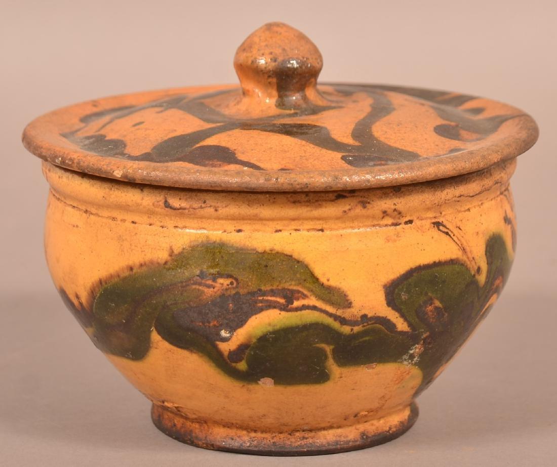 19th Century Drip Glazed Redware Covered Sugar Bowl.