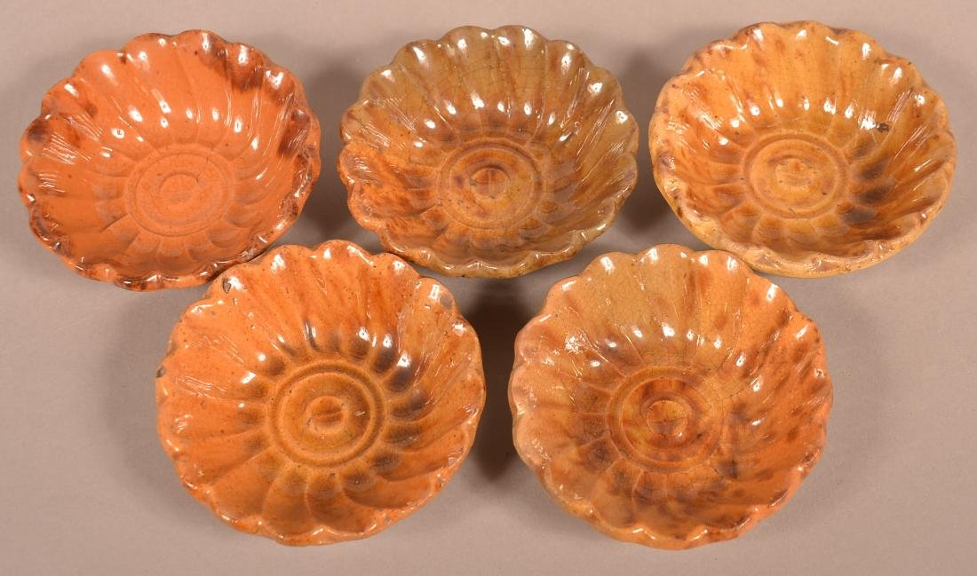 Five 19th Century Mottle Glazed Redware Jelly Molds.