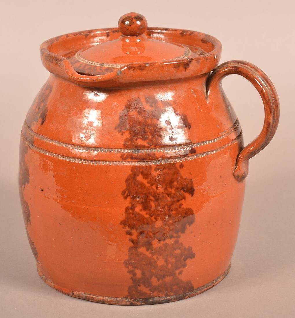 PA Sponge Glazed Redware Side Spout Covered Cider Jug.