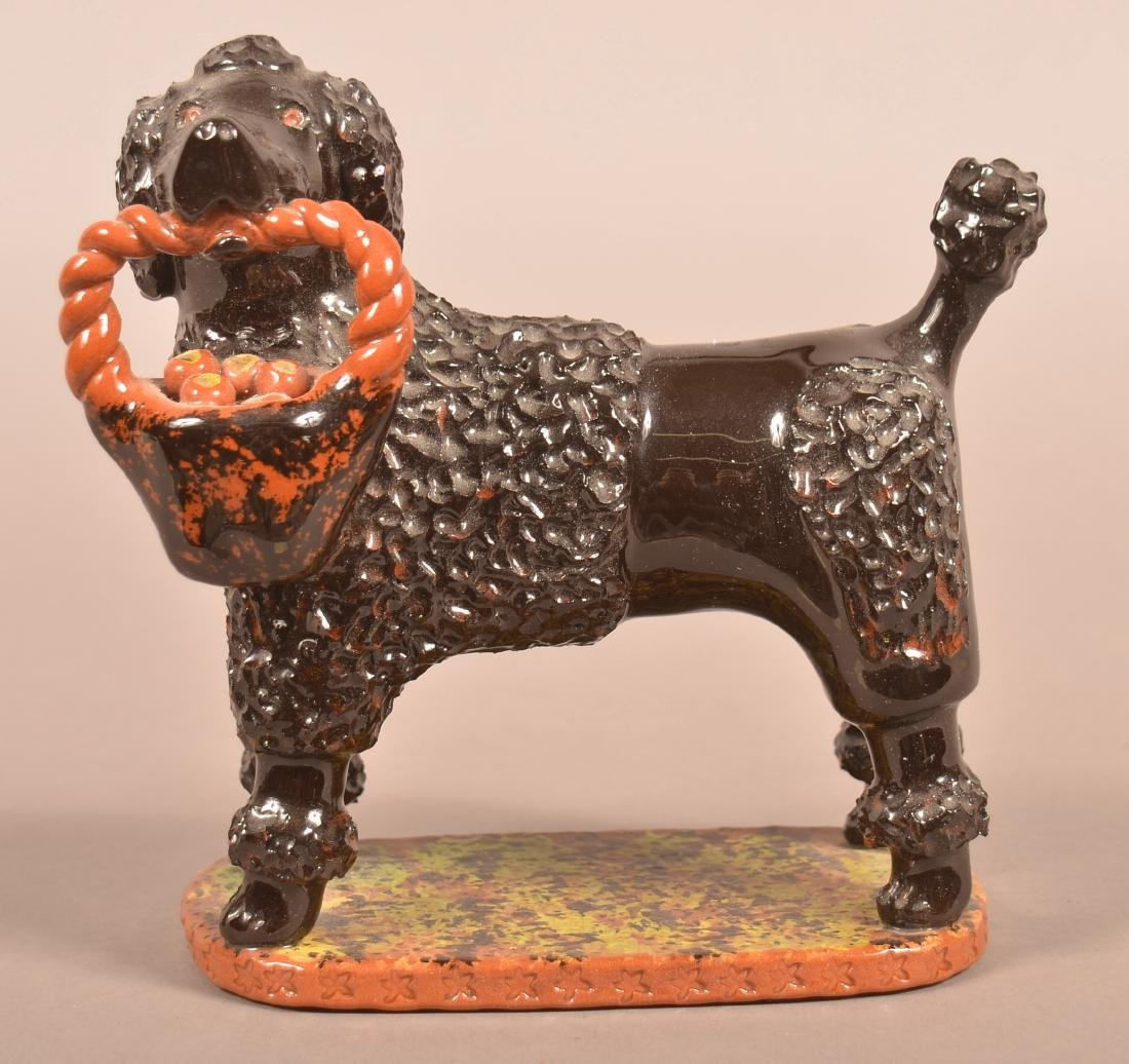 Breininger Pottery Glazed Redware Figure of a Dog.