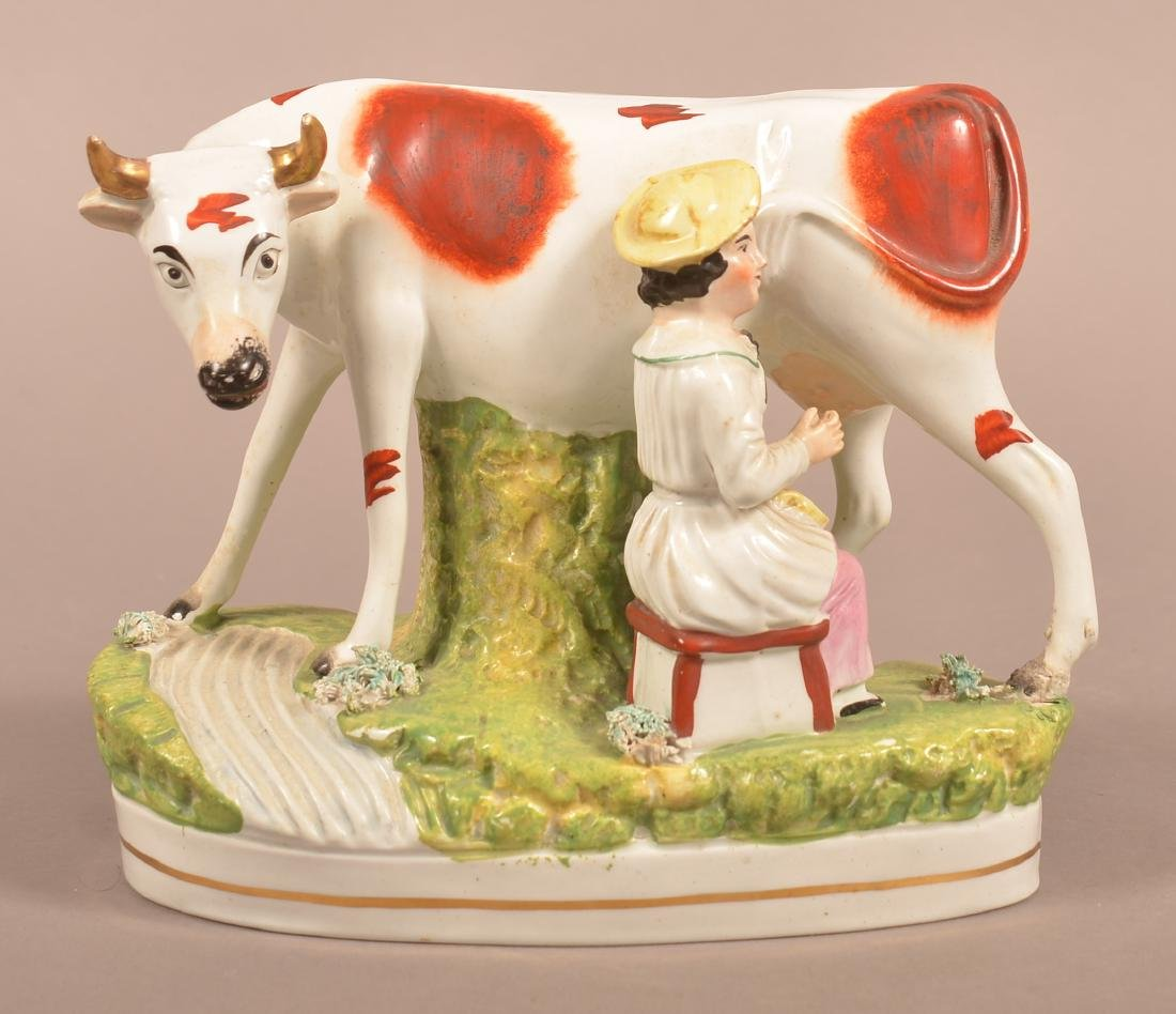 Staffordshire China Milk Maid with Cow Figure.