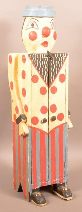 Vintage Folk Art Clown Form Child's Cabinet.