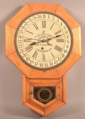 Waterbury Oak Case Advertising Wall Clock.