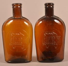 Two Amber Glass Whiskey Flasks.