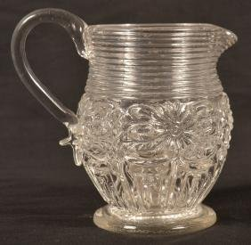 Blown Mold Colorless Glass Floral Cream Pitcher.