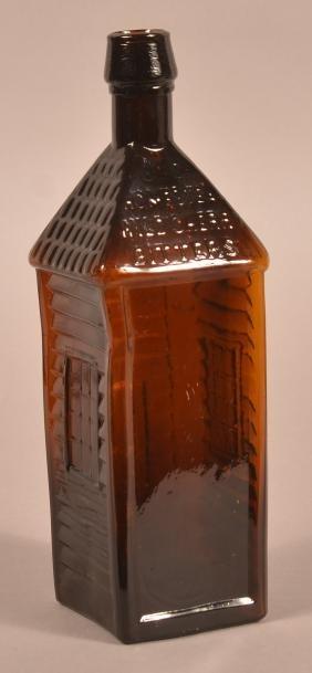 Amber Glass Cabin Form Bitters Bottle.