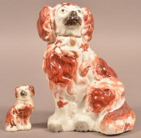 Two Staffordshire China Spaniel Figurines.