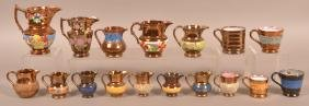 16 Various Copper Lustre Pitchers and Mugs.