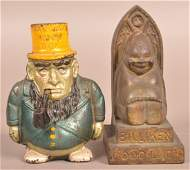 Two Cast Iron Figural Still Banks.