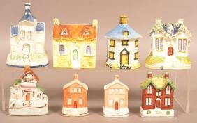 Eight Ceramic and Pottery Cottage Still Banks.
