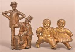 Two A.C. Williams Cast Iron Figural Still Banks.