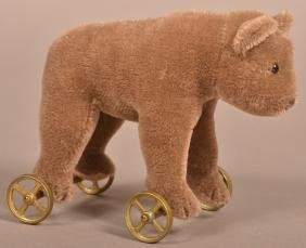 Vintage Steiff Mohair Bear on Metal Wheels.