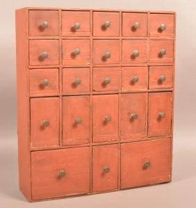 Red Painted Softwood 23 Drawer Apothecary Cabinet.